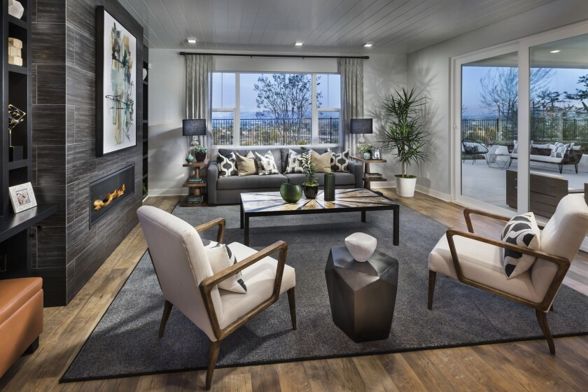 The contemporary Spanish-style homes in Lake Ridge are available in four open floor plans with three to five bedrooms, 2.5 to 4.5 bathrooms and two-bay garages.