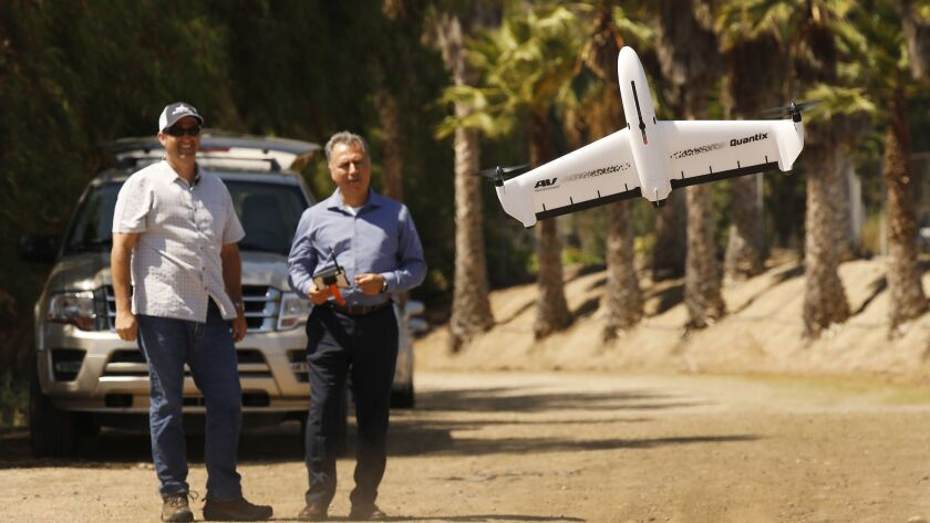 AeroVironment Chief Executive Wahid Nawabi, right, pilots the company's Quantix drone in July.