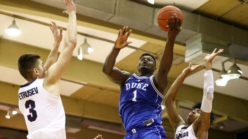 Zion Williamson of the Duke Blue Devils splits the Gonzaga defense for a layup during the first half.