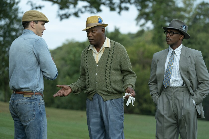 "Nicholas Hoult, left, Samuel L. Jackson and Anthony Mackie in a scene from Apple's ""The Banker."""