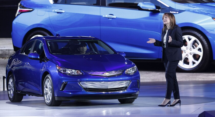 General Motors CEO Mary Barra reveals the new 2016 Chevrolet Volt to the media at the 2015 North American International Auto Show on Jan. 12 in Detroit.