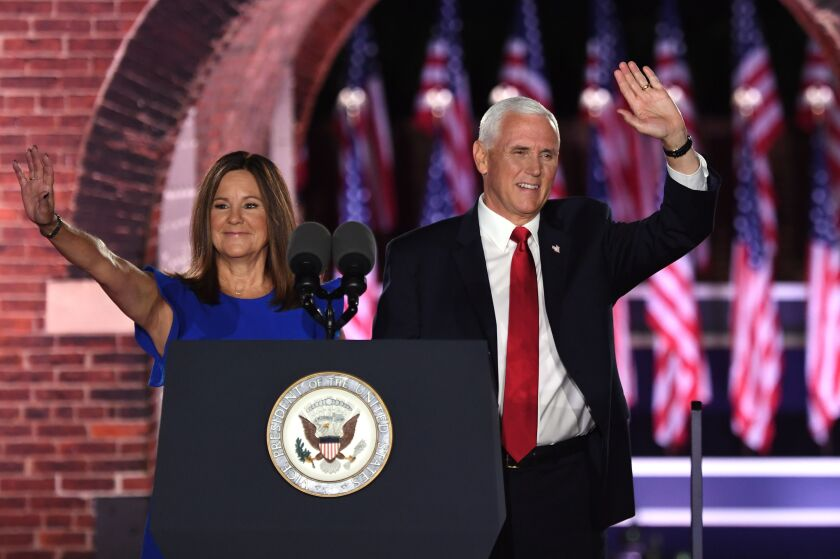 Vice President Mike Pence and his wife, Karen, wave at the Republican convention