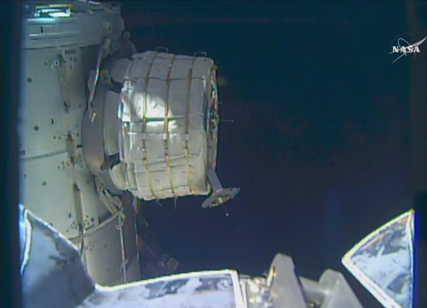 In this frame from NASA TV, a new experimental room at the International Space Station partially inflates Thursday, May 26, 2016. NASA released some air into the experimental inflatable room, but put everything on hold when problems cropped up. (NASA TV via AP)