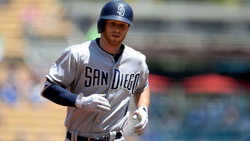 Padres third baseman Cory Spangenberg (15) rounds the bases after hitting a solo home run in the first inning against the Los Angeles Dodgers at Dodger Stadium on Aug. 13, 2017.