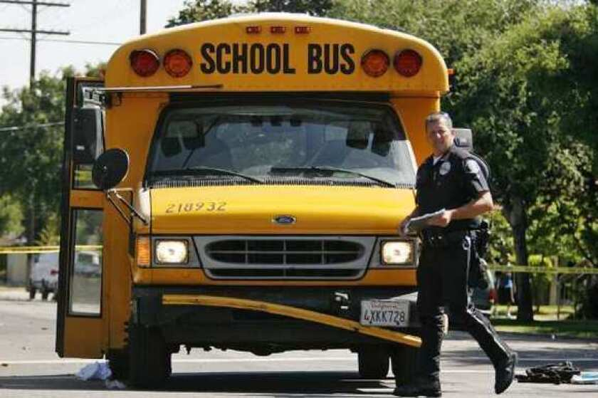 A 14-year-old boy died Thursday after he was struck by, and then trapped underneath, a school bus, police said.