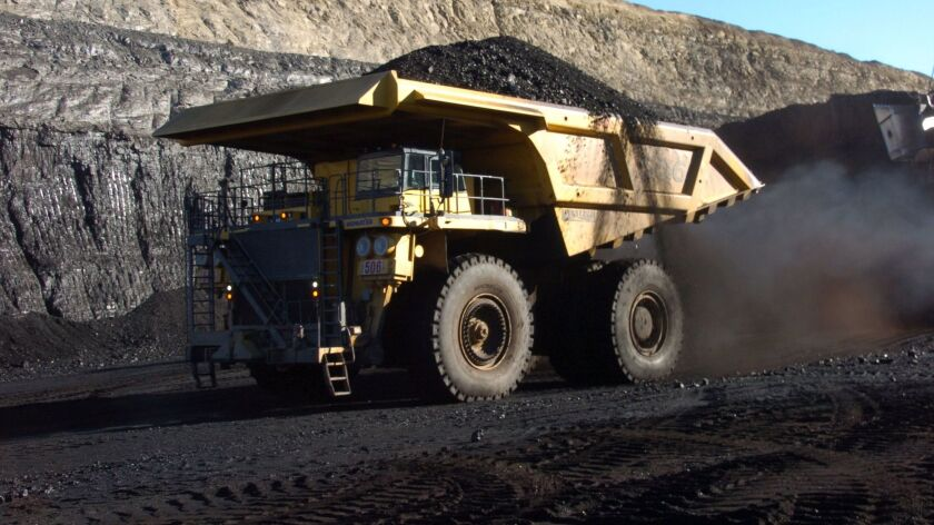 A truck capable of carrying 250 tons of coal carries a load from a strip mine near Decker, Mont.