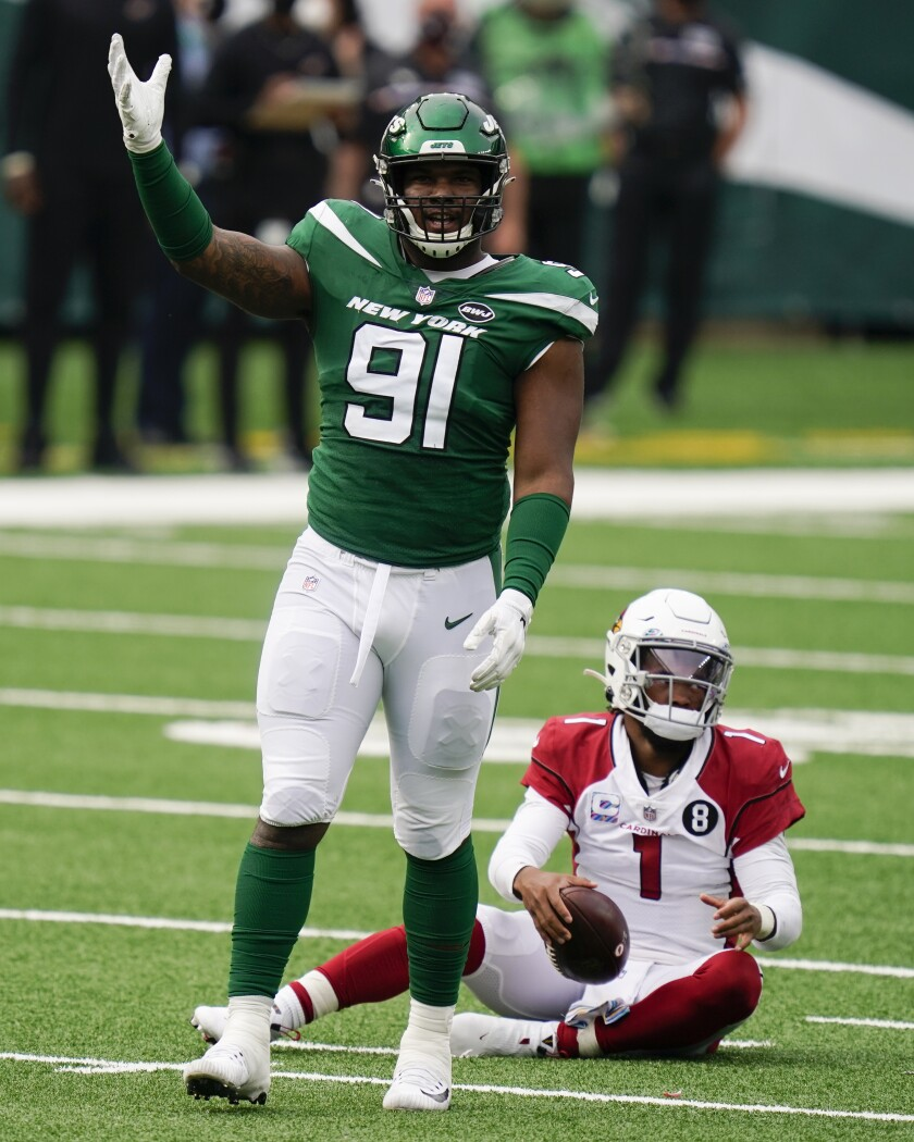 New York Jets defensive end John Franklin-Myers (91) reacts after sacking Arizona Cardinals quarterback Kyler Murray (1) during the second half of an NFL football game, Sunday, Oct. 11, 2020, in East Rutherford. (AP Photo/Seth Wenig)