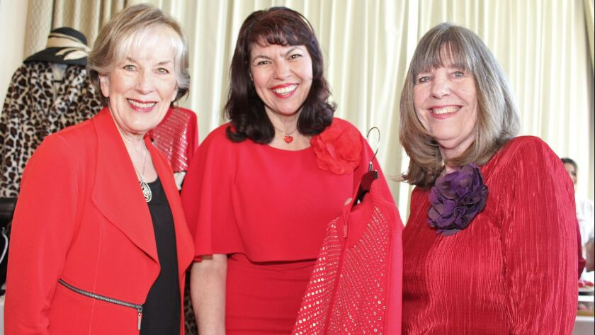 """All in red at Adventist Health Glendale's """"Be Our Valentine"""" Luncheon are, from left, Soroptimists S"""