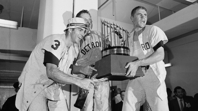 Dick McAuliffe, left, Jim Northrup, center, and Mickey Stanley, with the World Championship trophy