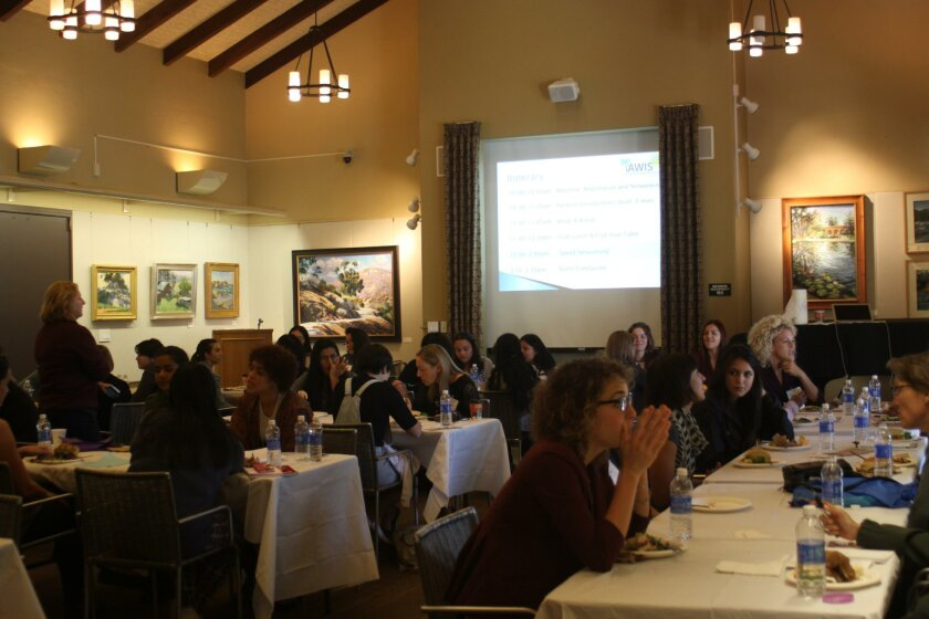 At La Jolla's Riford Library, 36 students and 12 panelists talk about science careers for women, Nov. 14.