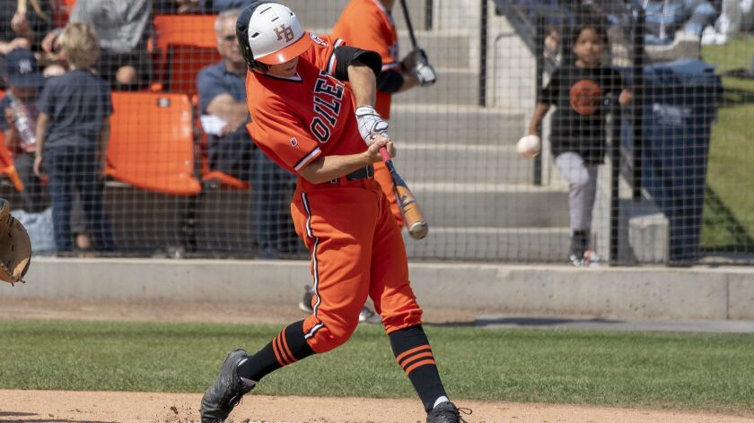 Huntington Beach's Jake Vogel, who has committed to UCLA after de-committing to the University of San Diego, hits a solo home run in the first inning against Vista Murrieta during a first round CIF Southern Section Division 1 playoff game on May 18.