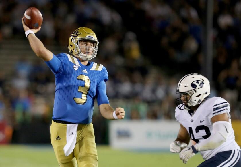 UCLA quarterback Josh Rosen is pressured by BYU linebacker Jherremya Leuta-Douyere into throwing his third interception of the first half.