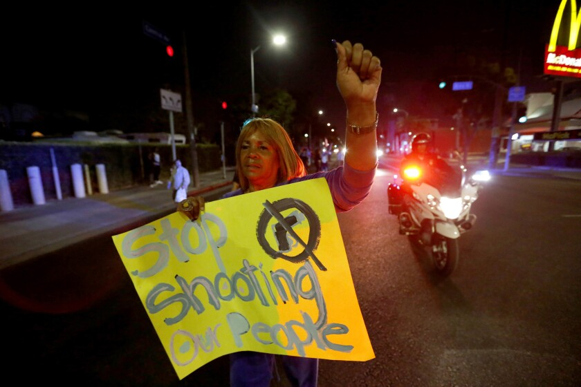 Marian Petersen, 71, whose last protest was in the 1965 Watts riots, marches down Central Avenue to the LAPD's Newton Division station after officers shot a Latino boy Sunday night.