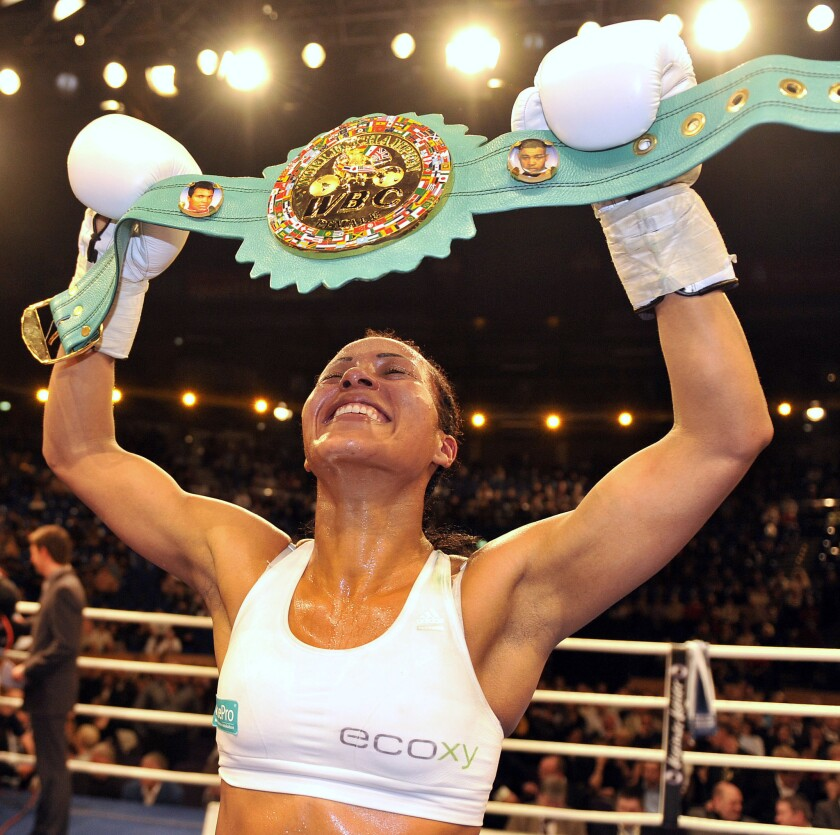 Norwegian boxer Cecilia Braekhus reacts after winning the WBA/WBC female welterweight title fight in Kiel, northern Germany, Saturday, March 14, 2009. Braekhus won the fight after ten rounds.