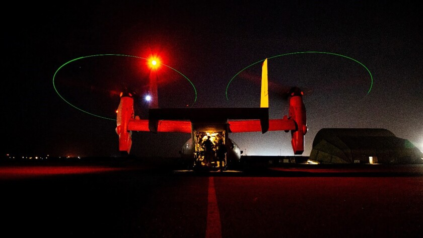 In this photo provided by U.S. Department of Defense, the Army's AH-64 Apache helicopter from 1st Battalion, 227th Aviation Regiment, 34th Combat Aviation Brigade, prepares to conduct overflights of the U.S. Embassy in Baghdad, Iraq, Tuesday, Dec. 31, 2019. Helicopters later launched flares as a show of presence while providing additional security and deterrence against protesters. (U.S. Army photo by Spc. Khalil Jenkins, CJTF-OIR Public Affairs via AP)