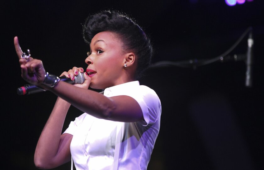 Janelle Monae performs during her set Saturday night set at the 2013 Coachella Valley Music & Arts Festival in Indio.