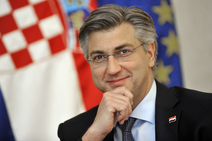 Andrej Plenkovic, Croatia's Prime Minister incumbent smiles as he addresses the media in Zagreb, Croatia, Thursday, April 9, 2020. Croatia is holding a parliamentary election on July 5, 2020, with no clear winner in sight as the ruling conservatives' bid for re-election faces a strong challenge from both liberal and right-wing groups. (AP Photo)