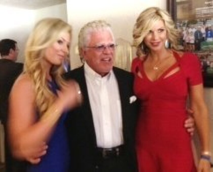 """Dallas resident Darwin Deason, who owns a La Jolla beach home, hosts reality TV's Alexis Bellino, or """"The Housewives of Orange County"""" (in red dress) and her  friend, Jackie Melby, at races."""