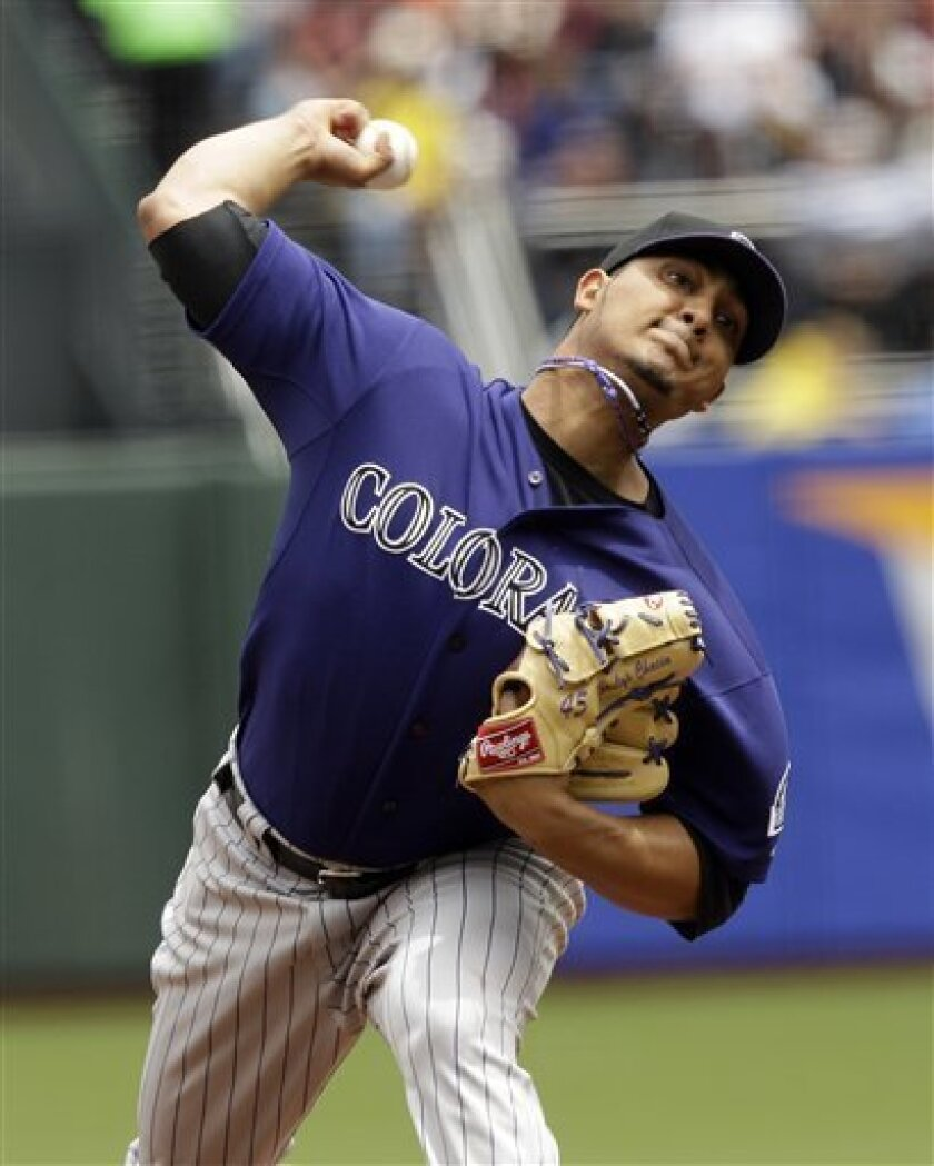Colorado Rockies starting pitcher Jhoulys Chacin throws to the San Francisco Giants during the first inning of a baseball game in San Francisco, Saturday, June 4, 2011. (AP Photo/Marcio Jose Sanchez)
