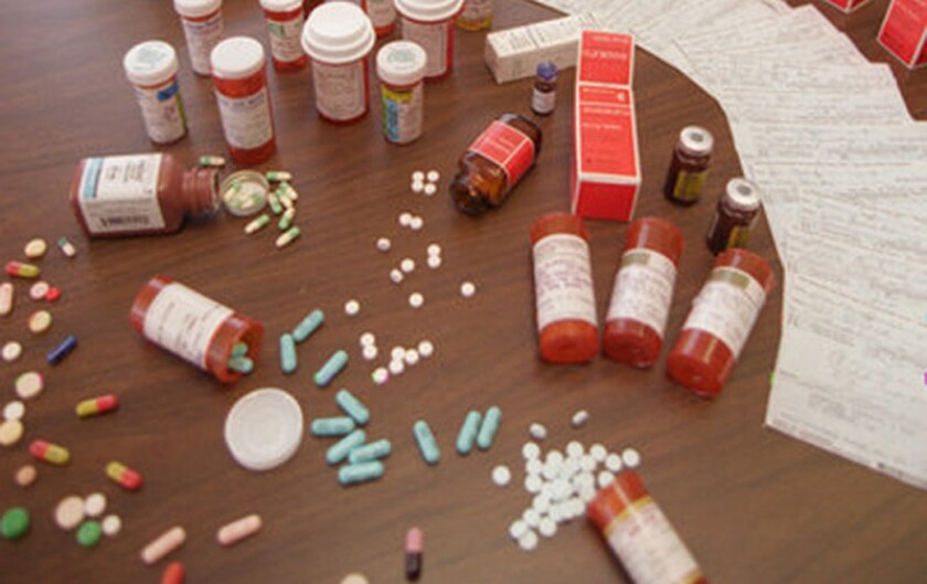 Federal authorities in Los Angeles on Tuesday announced charges against seven people who allegedly ran a trafficking ring of illegally-obtained prescription drugs out of a Los Angeles clinic. Pictured here are prescription drugs seized in unrelated raids in California.
