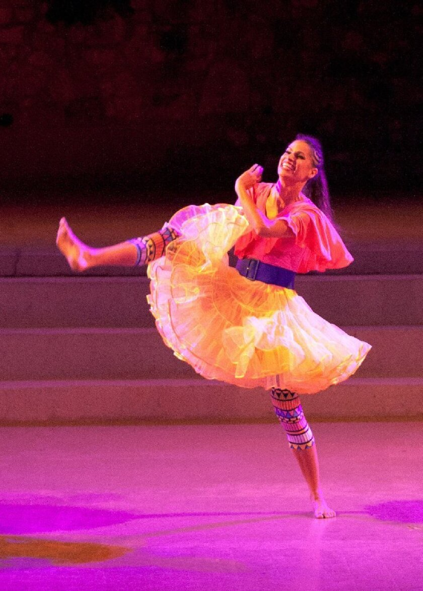 """Rachel Hernandez of the Viver Brasil dance troupe performs """"Para Xaxa"""" during a dress rehearsal at the Ford Amphitheatre."""
