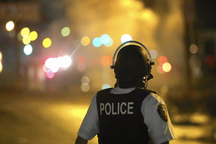 Atty. Gen. Eric H. Holder Jr. said many black residents of Ferguson, Mo., complained of harassment by white police officers.