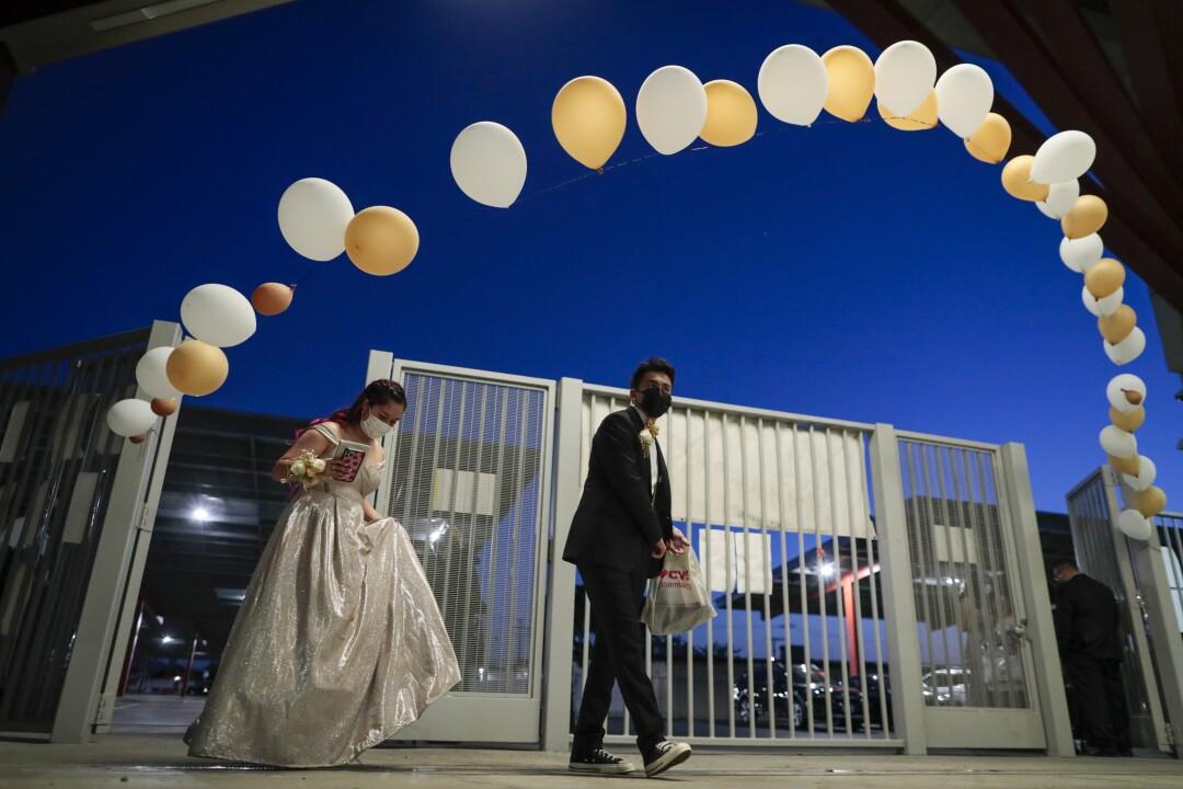 Jade Magallanes and her boyfriend, Jose Gonzalez, arrive at Sierra Vista for prom.