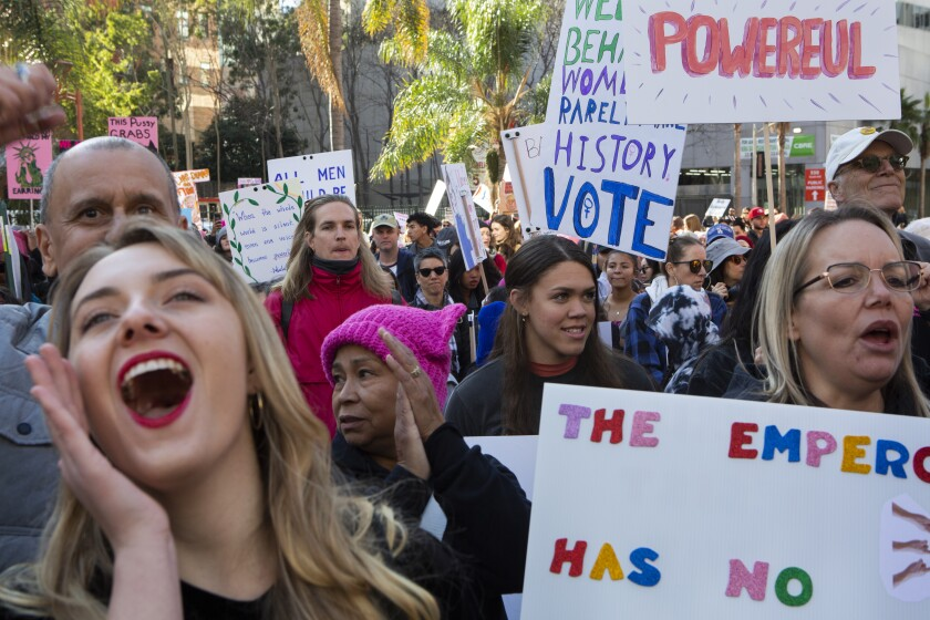 LOS ANGELES, CA-JANUARY 18, 2020: Claire New-Duval, left, and Trinity Castaneda, 18, cheer during the 4th annual Women's March Los Angeles kickoff at Pershing Square in dowtown Los Angeles. (Gabriella Angotti-Jones/Los Angeles Times)