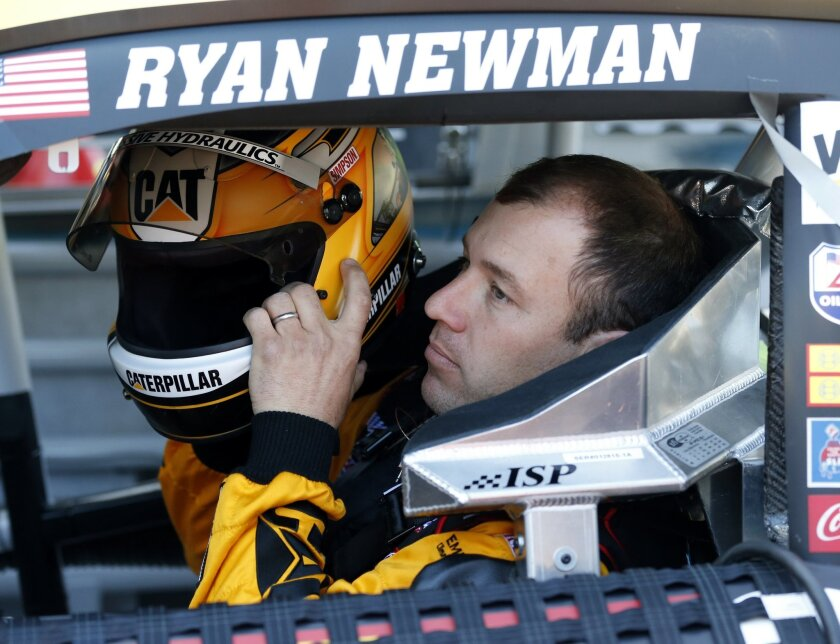 Driver Ryan Newman prepares before practice for Sunday's NASCAR Daytona 500 Sprint Cup series auto race at Daytona International Speedway in Daytona Beach, Fla., Thursday, Feb. 18, 2016. (AP Photo/Wilfredo Lee)