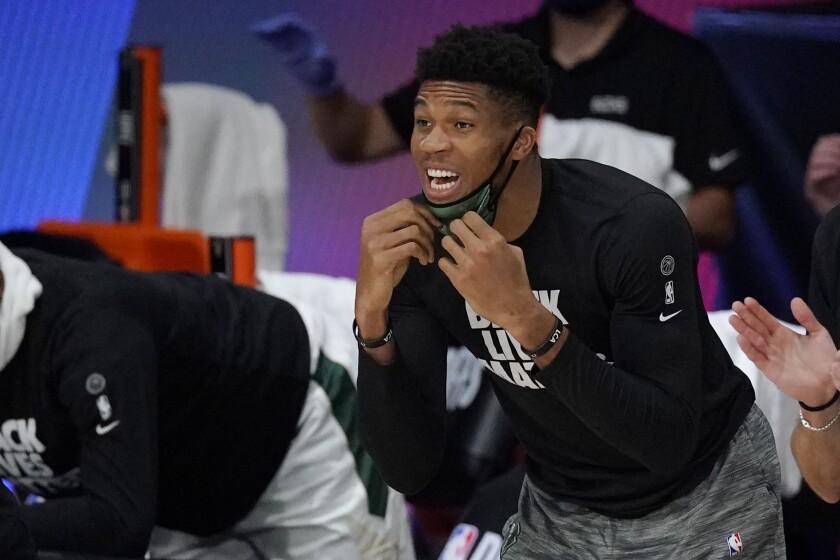 Milwaukee Bucks' Giannis Antetokounmpo shouts from the bench.