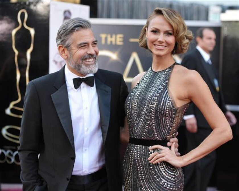 Actor George Clooney, left, and Stacy Keibler arrive at the Oscars at the Dolby Theatre on Sunday Feb. 24, 2013, in Los Angeles. (Photo by John Shearer/Invision/AP)