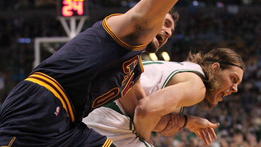 Cleveland Cavaliers forward Kevin Love, left, and Boston Celtics center Kelly Olynyk tangle while chasing after a loose ball during the first quarter of the Cavaliers' 101-93 win in Game 4 of the Eastern Conference quarterfinals on April 26.