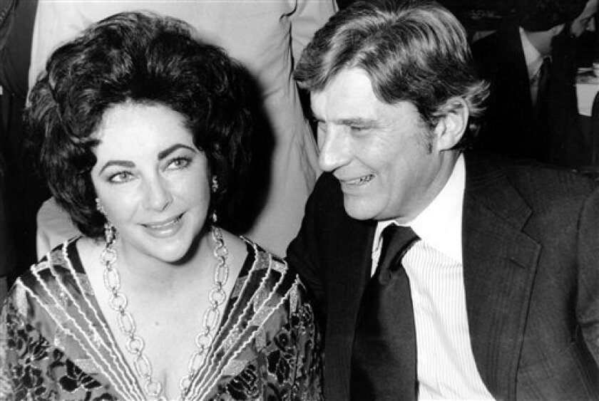 FILE - This Jan. 30, 1977 file photo shows actress Elizabeth Taylor and her husband, former secretary of the U.S. Navy John Warner, at the 42nd New York Film Critics Circle Awards dinner in New York. Publicist Sally Morrison says Taylor died Wednesday, March 23, 2011 in Los Angeles of congestive he