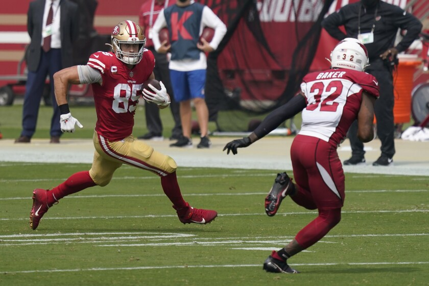 San Francisco 49ers tight end George Kittle (85) runs against Arizona Cardinals strong safety Budda Baker (32) during the first half of an NFL football game in Santa Clara, Calif., Sunday, Sept. 13, 2020. (AP Photo/Tony Avelar)