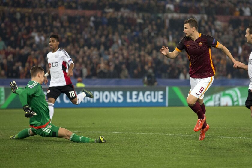 Roma's Edin Dzeko scores during the Champions League group E soccer match between Roma and Bayer Leverkusen at the Olympic stadium, in Rome, Italy, Wednesday, Nov. 4, 2015. (AP Photo/Andrew Medichini)