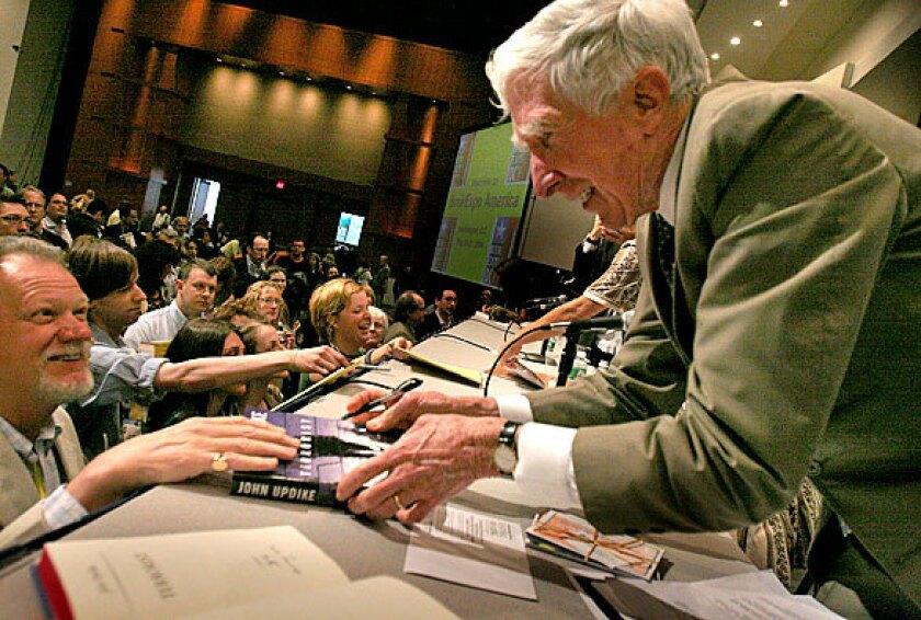 The annual BookExpo, rescheduled from May to July, is where authors like John Updike, seen at the 2006 event three years before his death, met booksellers and the public.