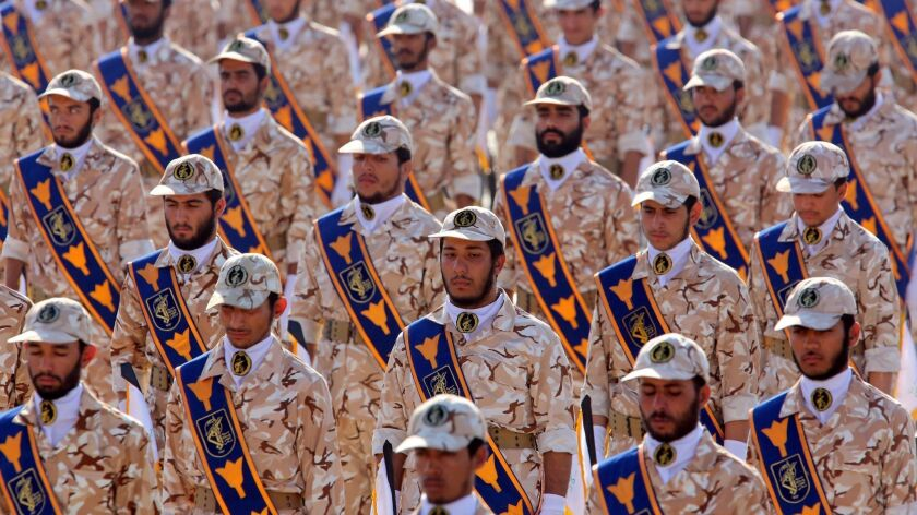 Soldiers in Iran's Islamic Revolutionary Guard Corps march in Tehran during the annual military parade marking the Iraqi invasion in 1980, which led to an eight-year war. President Trump designated the Revolutionary Guard a terrorist organization on April 8, 2019.