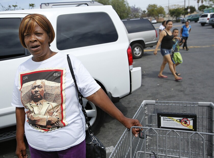 "Compton resident Ellen Harris, outside a supermarket, says, ""We are not all criminals in Compton."""