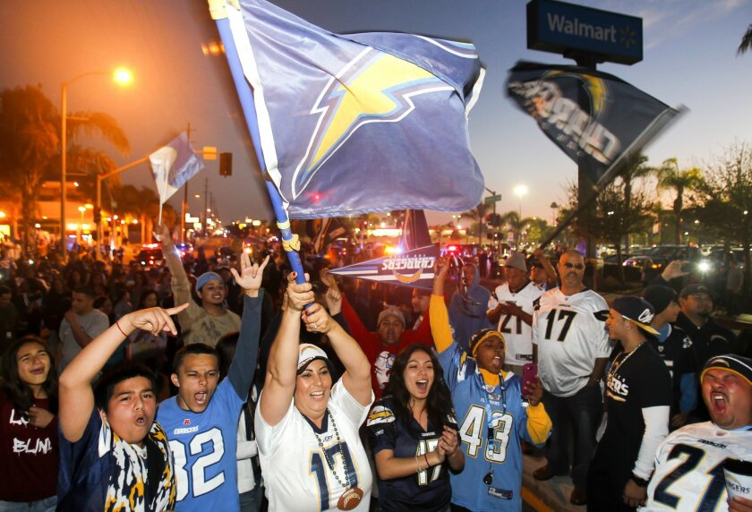 Charger fans celebrate the 2013-2014 season in the middle of Highland Avenue after the team lost to the Denver Broncos in the second round of the playoffs, ending their hopes for a Super Bowl, for now.