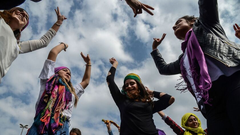 Diyarbakir, Turkey: Women flash victory signs during a demonstration as part of International Women's Day.