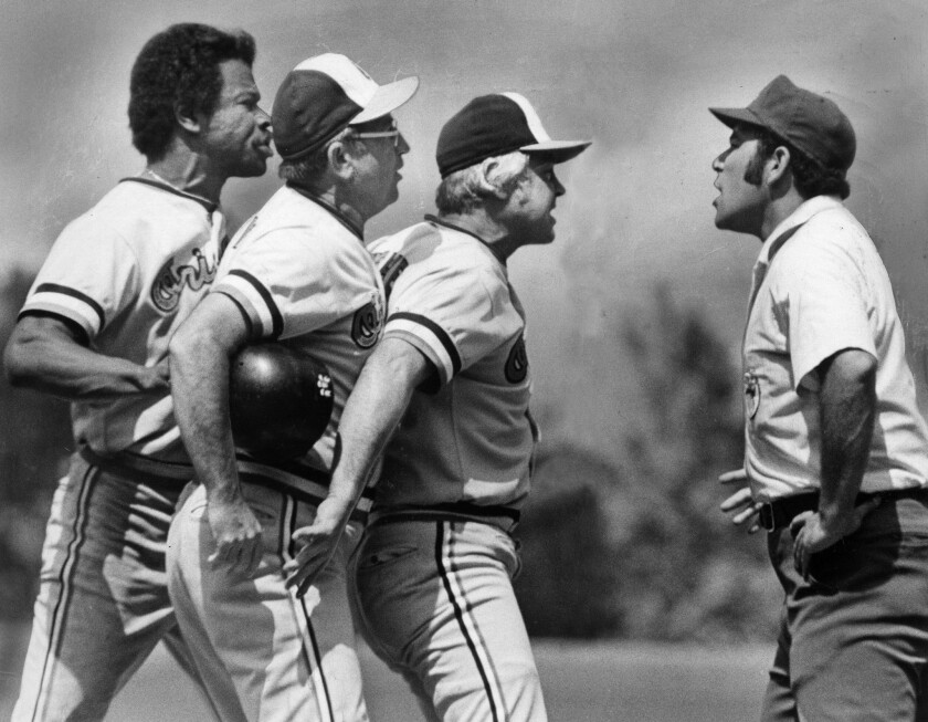 July 11, 1976: Baltimore Orioles appear to be lining up to voice their opinions to umpire Al Clark,