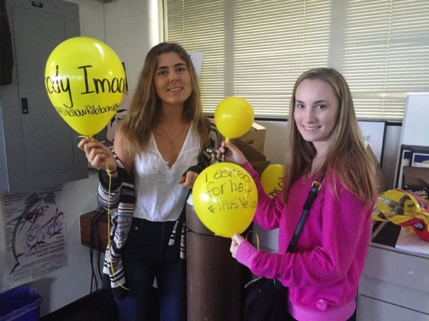 PALS president and vice president Avery Spicker and Chelsea Barrows with Teen Trouble Balloons.