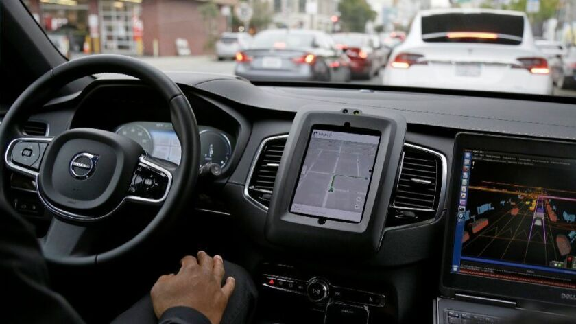 An Uber self-driving car is tested in San Francisco in December. Later this year, California testing may begin of autonomous vehicles without steering wheels or any human co-drivers.