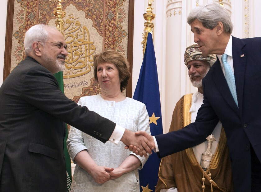Secretary of State John F. Kerry, right, and Iranian Foreign Minister Javad Zarif shake hands in Muscat, Oman, on Nov. 9. With them are European Union envoy Catherine Ashton and Omani Foreign Minister Youssef ibn Alawi.