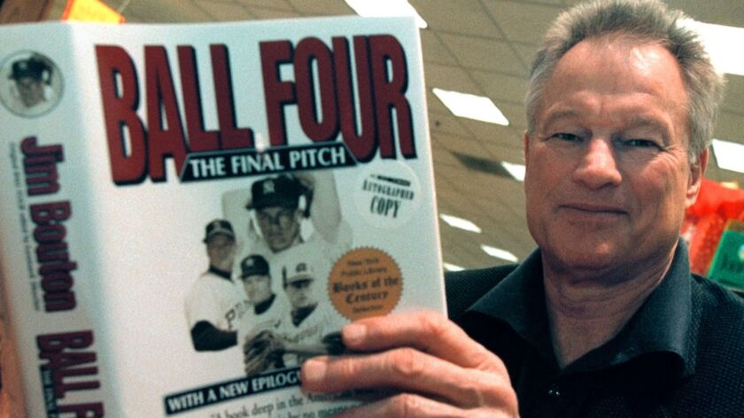 """Former New York Yankees pitcher Jim Bouton signs copies of his book """"Ball Four: The Final Pitch,"""" on November 27, 2000."""