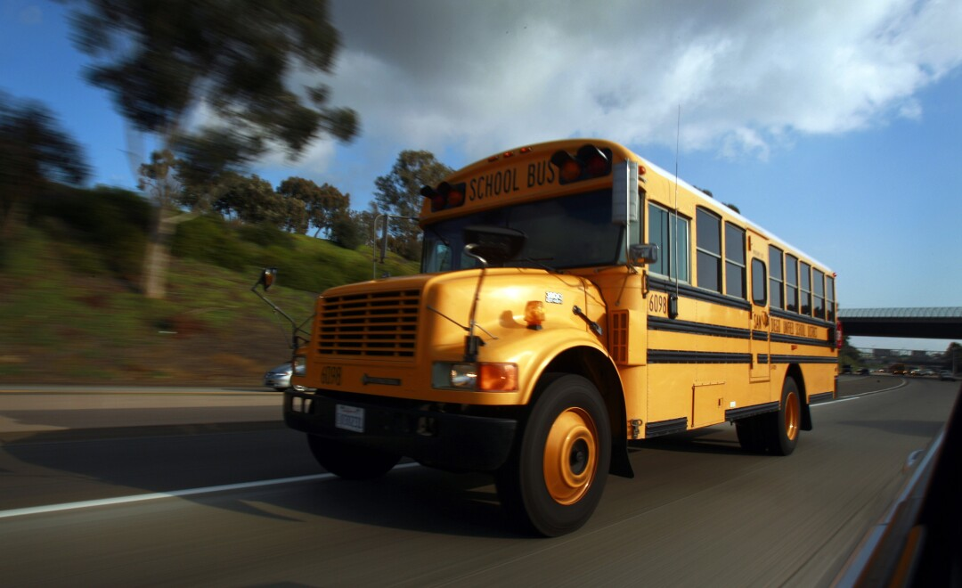 A San Diego Unified School bus drives on I-805 after picking up students after school on Wednesday, Dec. 14, 2011.