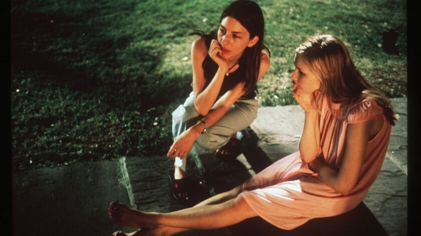 "Sofia Coppola directs Kirsten Dunst on the set of ""The Virgin Suicides."""