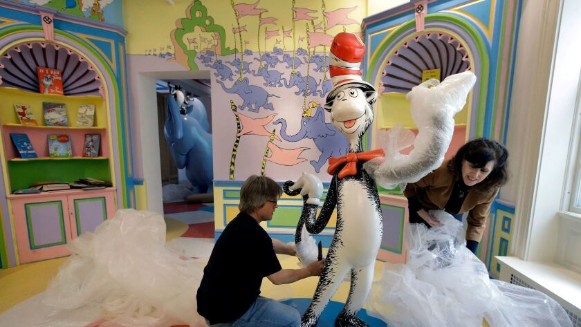John Simpson, project director of exhibitions for the Amazing World of Dr. Seuss Museum, and his wif