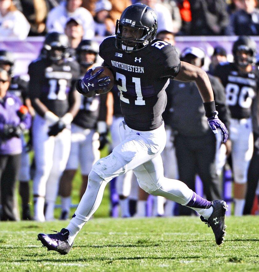Northwestern running back Justin Jackson (21) runs against Penn State during the second half of an NCAA college football game in Evanston, Ill.,  Saturday, Nov. 7, 2015. (AP Photo/Matt Marton)