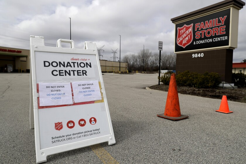 FILE - In this April 1, 2020 file photo, a closed sign is displayed outside a Salvation Army store and donation center in Glenview, Ill. Across the country, drug and alcohol recovery programs claiming to help the poor and the desperate are instead conscripting them into forms of indentured servitude, requiring them to work without pay or for pennies on the dollar, in exchange for their stay. For the first time, Reveal from The Center for Investigative Reporting has determined how widespread these programs have become. In 1990, in response to a complaint from a former participant, the Labor Department launched an investigation into the nation's largest chain of work-based rehabs, The Salvation Army, which operates about 100 programs across the country. At The Salvation Army's rehabs, participants were required to work full time processing donations for the organization's thrift stores, receiving a stipend of only $5 to $20 a week. The department found The Salvation Army had violated labor laws and ordered the nonprofit to pay its participants minimum wage. The Salvation Army refused to comply. It sued, then enlisted members of Congress to defend the venerable charity. Within a month, the department backed off.(AP Photo/Nam Y. Huh, File)